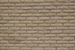 装饰背景纹理茶黄的砖墙 免版税库存图片