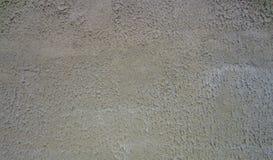 装饰膏药-外套 混凝土墙的参差不齐的灰色纹理 免版税库存图片