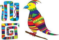 装饰色的动物:蛇和鸟 免版税库存照片