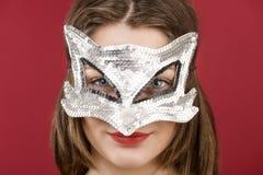 装饰面具的女孩 免版税图库摄影