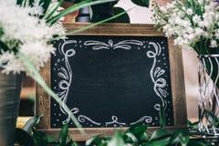 装饰黑板在花卉商店 图库摄影