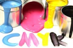装cmyk油漆于罐中 库存照片