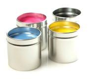装cmyk油漆于罐中 免版税库存照片