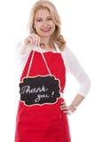 围裙的女性厨师 免版税库存图片