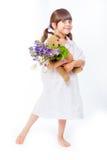 褂子的女孩有花束和女用连杉衬裤的 免版税图库摄影