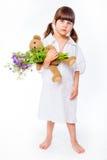 褂子的女孩有花束和女用连杉衬裤的 免版税库存图片