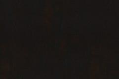 黑褐色作为背景的皮革纹理 图库摄影