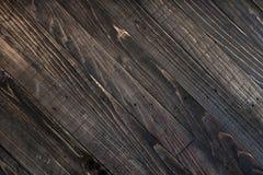 黑褐色木纹理背景 免版税库存照片