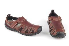 褐色红色皮革凉鞋 库存照片