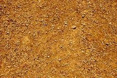 褐色被颗粒化的地面的特写镜头 免版税库存照片