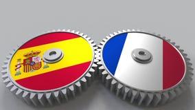 西班牙和法国的旗子捕捉的齿轮的 国际合作概念性3D翻译 库存例证