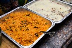 西班牙大米和低贱回锅煎炸菜豆 免版税库存照片