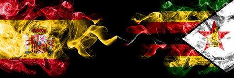 西班牙对津巴布韦,肩并肩被安置的津巴布韦发烟性神秘的旗子 厚实色柔滑抽西班牙语和津巴布韦的旗子, 免版税图库摄影