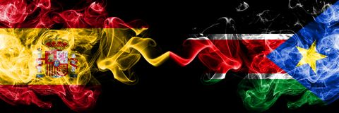 西班牙对肩并肩被安置的南苏丹发烟性神秘的旗子 厚实色柔滑抽西班牙语和南苏丹旗子  库存照片