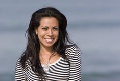 西班牙微笑的妇女 免版税库存图片