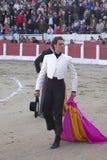 西班牙斗牛士Finito对转动的de科多巴荣誉与一个帽子在他的手上 库存图片