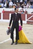 西班牙斗牛士Finito对转动的de科多巴荣誉与一个帽子在他的手上 库存照片