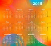 西班牙日历在2015年在抽象圈子 首先星期一 图库摄影