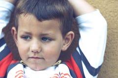 西班牙男孩葡萄酒画象有蓝眼睛的 免版税库存图片