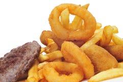 西班牙组合盛肉盘用汉堡、炸丸子、calamares和fr 免版税图库摄影