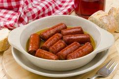 西班牙语Cuisune。辣香肠。Chistorra。 库存照片
