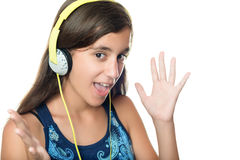 西班牙青少年听到与一个激动的表示的音乐 免版税库存图片