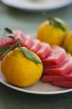 西瓜、普通话和蜜桔果子早餐  库存照片