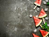 西瓜在木棍子的冰淇凌 库存照片