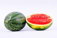 西瓜是在被隔绝的白色背景的健康甜果子 免版税库存照片