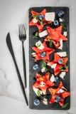西瓜沙拉用希脂乳,薄菏,蓝莓 免版税库存图片
