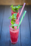 西瓜饮料用薄菏 免版税图库摄影