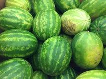 西瓜 绿化在外部,红色在里面 免版税库存照片