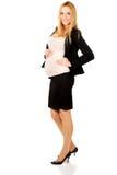 西装的孕妇 免版税图库摄影