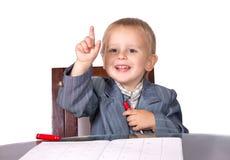 西装的小男孩来了想法 免版税库存照片