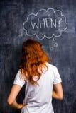 要求红头发人的妇女,当 免版税图库摄影