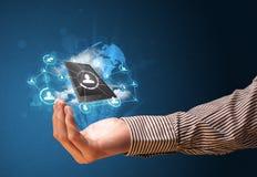 覆盖技术在商人的手上 免版税库存图片