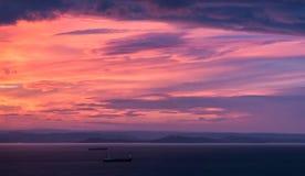 覆盖黑暗的海景天空日落 免版税图库摄影