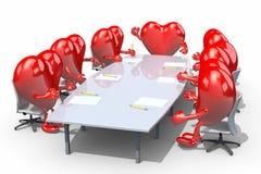 见面在桌附近的许多心脏 免版税库存照片