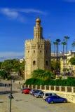 观点的金黄Tower Torre del塞维利亚,安大路西亚,在河瓜达尔基维尔河的西班牙Oro日落的 库存照片