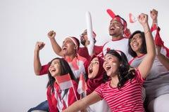 观看以兴奋的印度尼西亚支持者 免版税库存照片