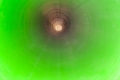观看长的塑料管的里面在地面下 免版税库存照片