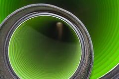 观看长的塑料管的里面在地面下 图库摄影