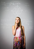 解决等式的女孩 库存照片