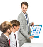 解释项目的商人对他的工友 库存图片