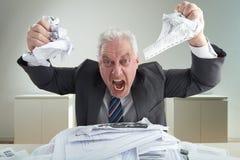 解除重音的疯狂的商人画象 免版税库存图片