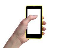 触摸屏手机黑和黄色手中 免版税库存照片