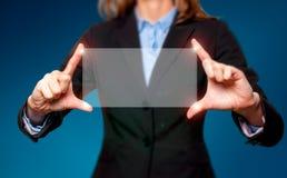 触摸屏概念-女实业家-储蓄图象 库存图片