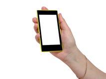 触摸屏黄色黑色手机在手中 库存照片