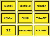警告多语种符号 免版税图库摄影