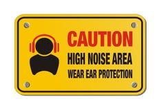 警告高噪音地区,穿戴耳朵保护-黄色标志 免版税库存图片